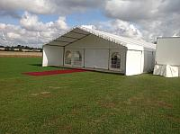 Marquee with a veranda entrance complete with red carpet.